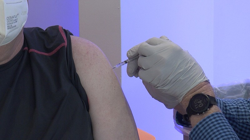 A man getting the COVID-19 vaccine at the Grossmont Center Mall vaccination