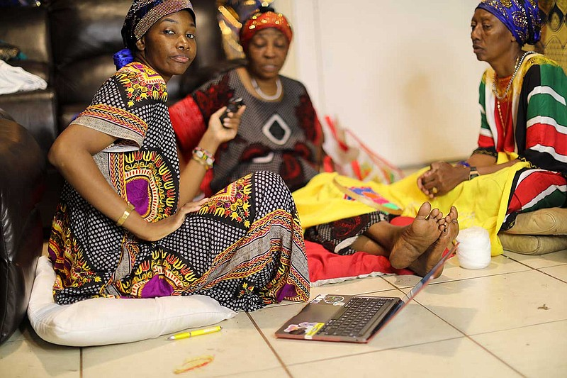 In a photo taken by her 11-year-old son Osman, Famo Musa interviews her mothe...