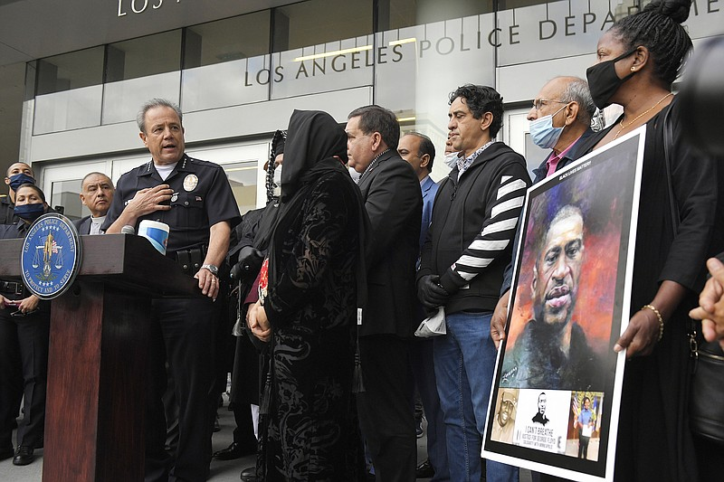 In this June 5, 2020, file photo, Los Angeles police chief Michel Moore, left...
