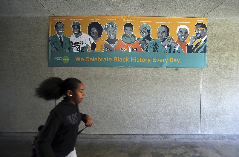 A Black History Day banner is on display at Animo Westside Charter Middle Sch...