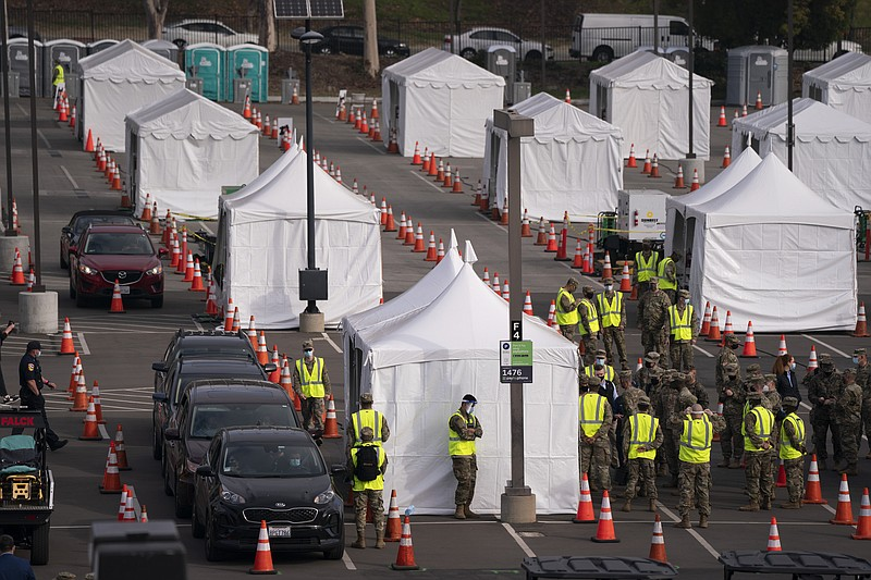 Motorists wait to get their COVID-19 vaccine at a federally-run vaccination s...