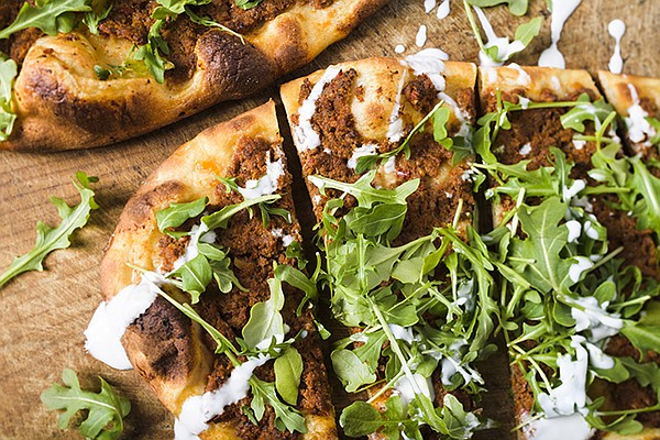 Lahmajoun, a yogurt flatbread topped with spiced meat and...