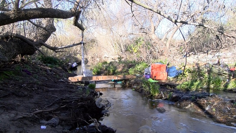 Trash left behind from homeless encampments at the Quarry Creek Preserve in O...
