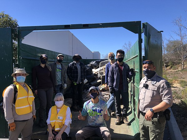 "Volunteers with the ""San Diego Habitat Conservancy"" and ""..."