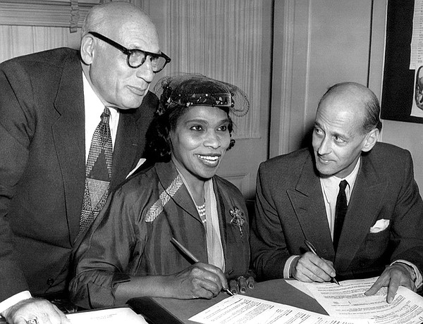 Singer Marian Anderson signs a contract with Metropolitan...