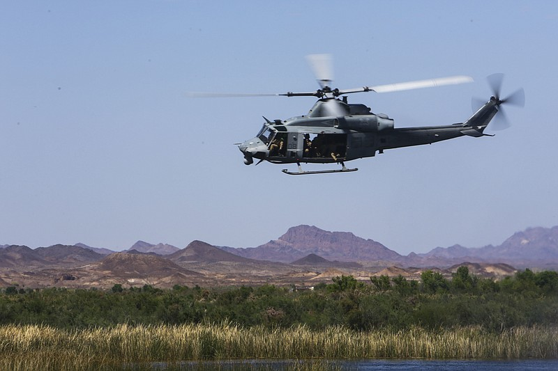A UH-1Y  helicopter participating in a helocast exercise at Ferguson Lake nea...