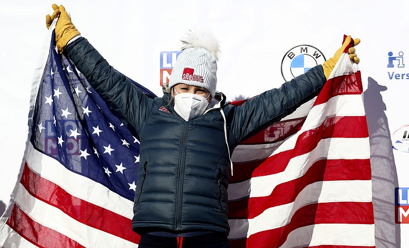 Bobsleigh pilot Kaillie Humphries of the United States celebrates on the podi...