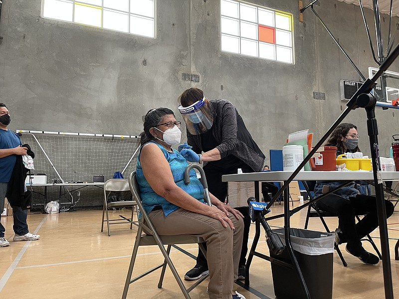 A patient receives a COVID-19 vaccine at Border View Family YMCA in Otay Mesa...