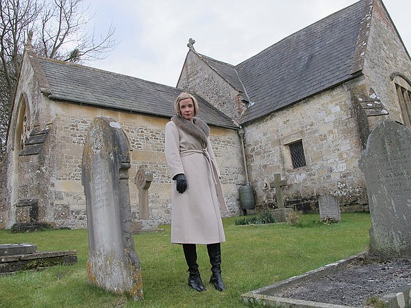 Lucy Worsley in Churchyard where a boy in Rode Hill House...