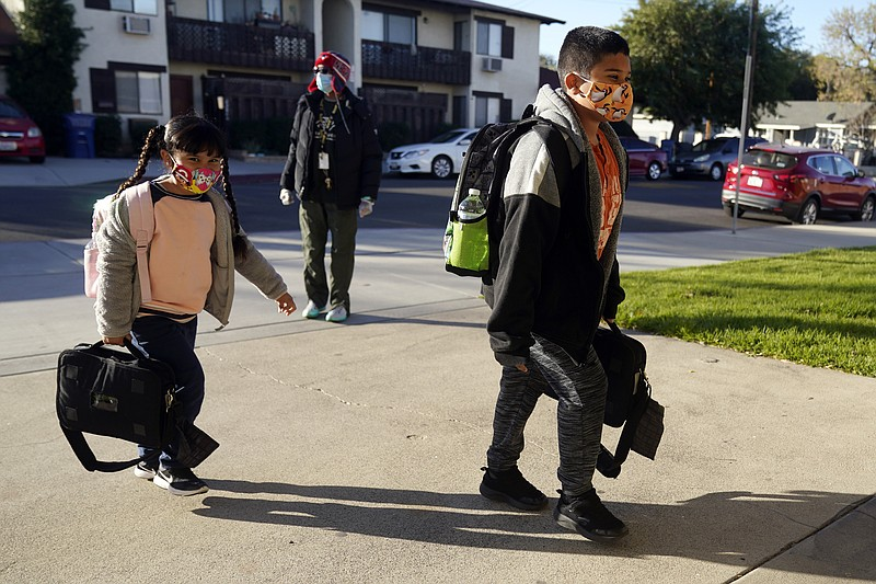 Students arrive at Newhall Elementary School Thursday, Feb. 25, 2021, in Sant...