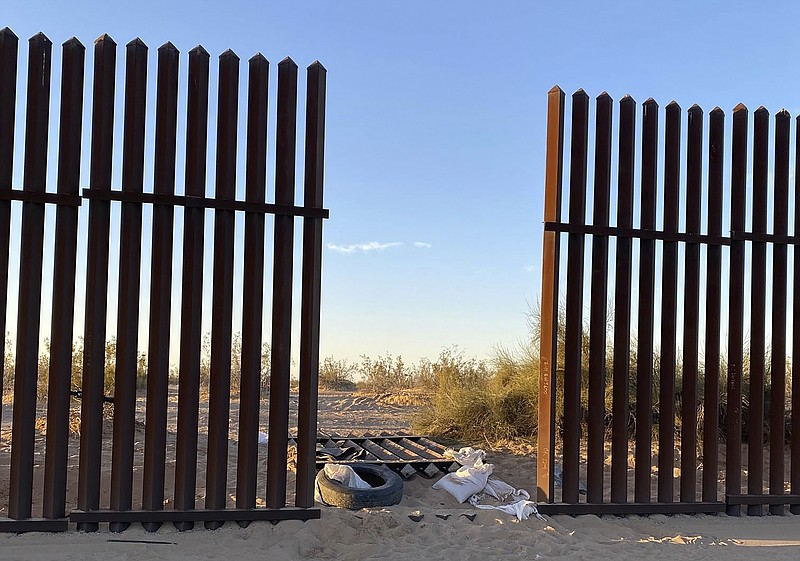 This photo provided by the US Customs and Border Protection shows a hole cut ...