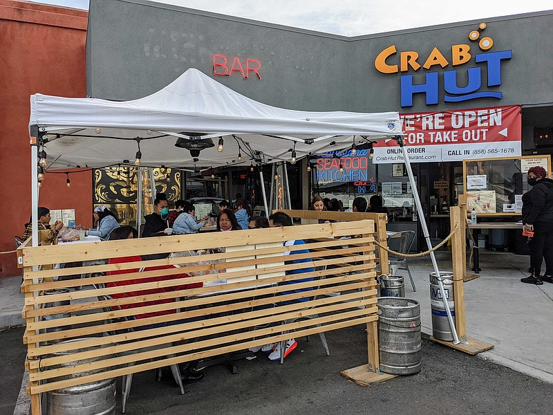 Customers seated outside in the parking lot at Crab Hut restaurant in Kearny ...