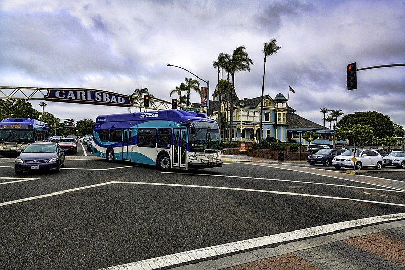 North County Transit Breeze bus going under the Carlsbad sign in this undated...