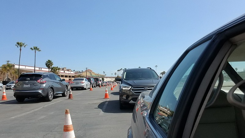 A line of patients in cars waiting to get a COVID-19 vaccine at the Del Mar V...