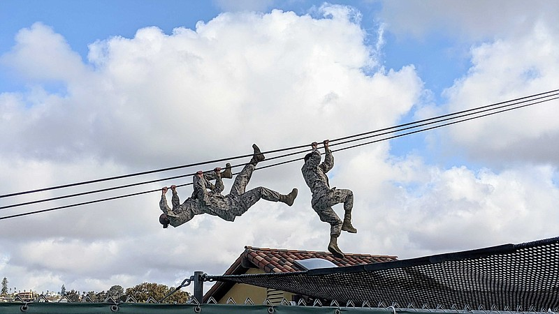 Female Marine recruits on the Slide for Life obstacle course at Marine Recrui...
