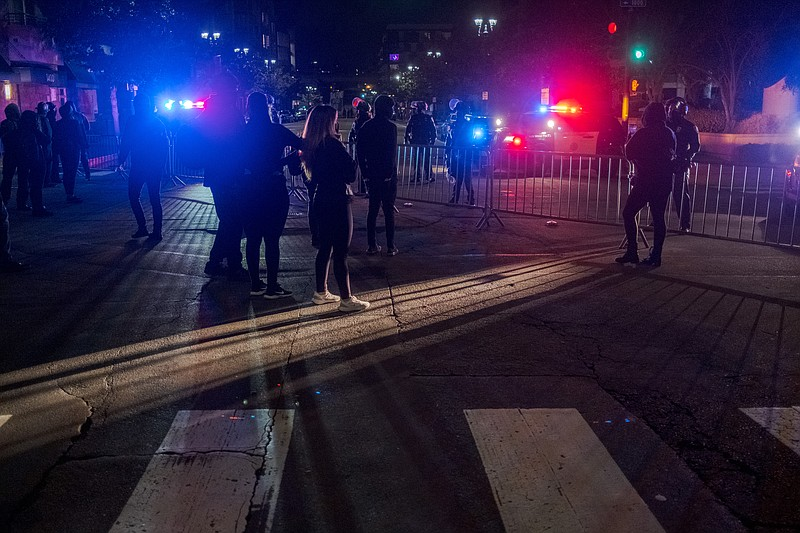 Protesters gathered at the San Diego Police Department Headquarters after vid...