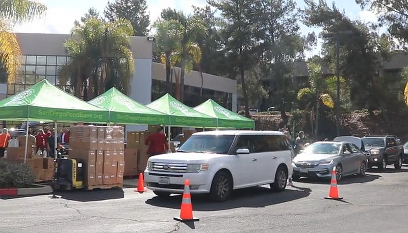 Cars waiting in line at the San Diego Food Bank's 35th High Volume Drive-Thro...