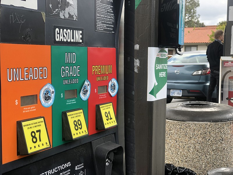 A man fills up his car with gasoline at a 7-11 gas station in Encinitas, Mar....