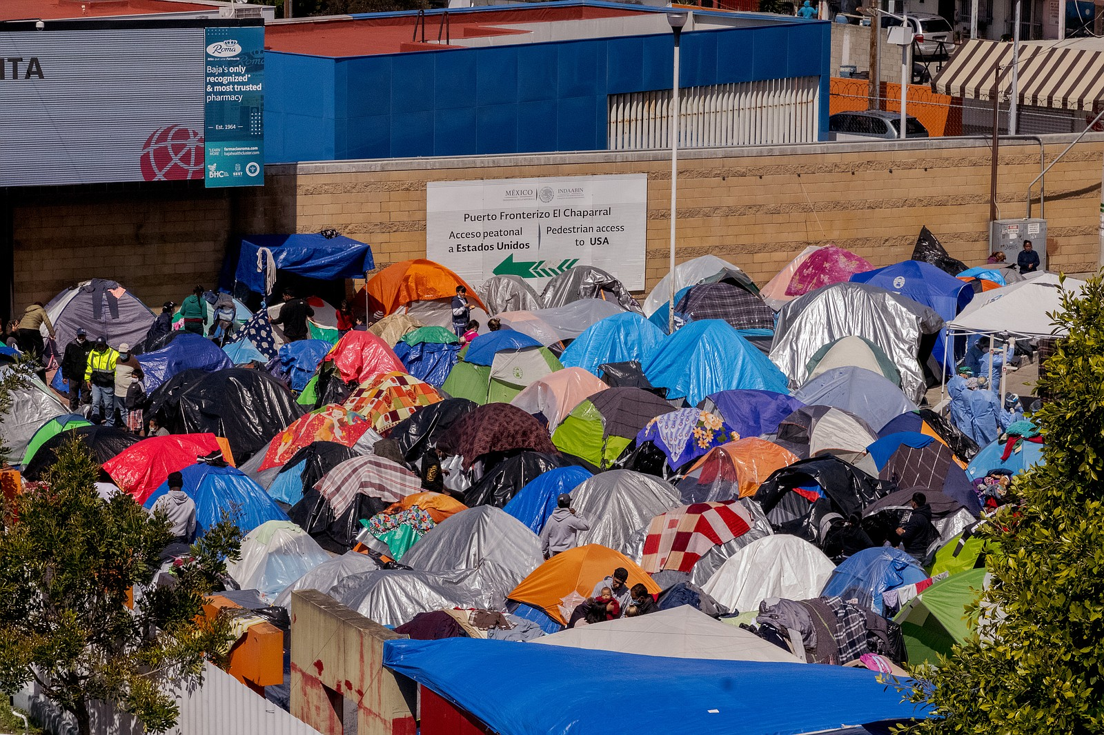 Hundreds of asylum-seekers are camping out at the El Capparal plaza on Mexica...