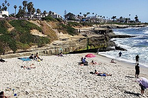 Photo for Sun's Out, Surf's Up And California's Reopening More Widely
