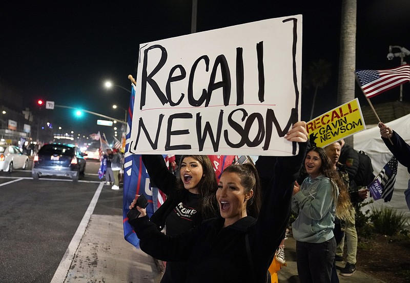 In this Nov. 21, 2020, file photo, Trump supporters shout slogans while carry...