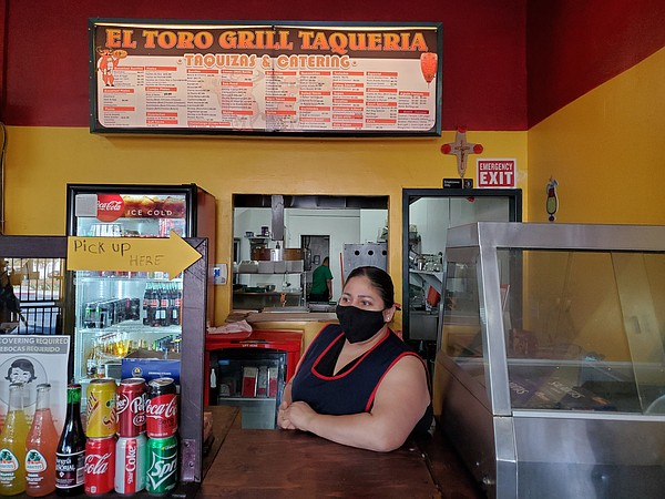 Maribel Estrada stands at the counter of her City Heights...