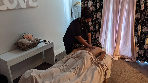 Veronica Densey gives a massage to a client at her busine...