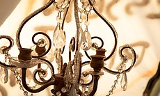 An ornate lamp sits inside a tent in the Calexi...