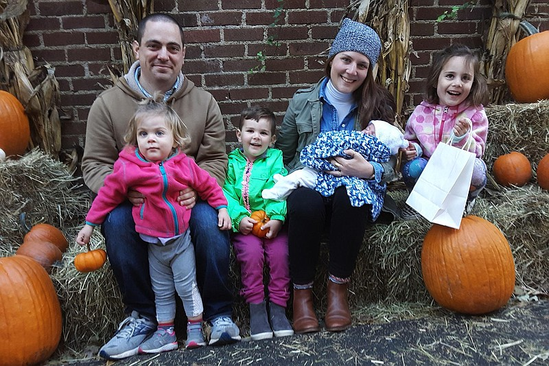 Former servicemember Stephen Kennedy, with his wife Catherine and four childr...