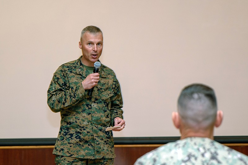 U.S. Marine Corps Col. Christopher J. Bronzi, center, commanding officer of 1...