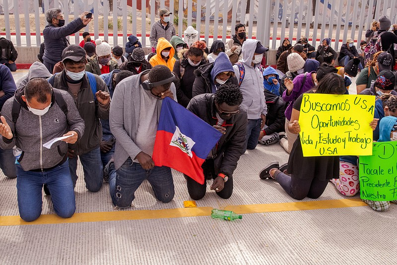 Migrants hoping to claim asylum in the United States marched from there camp ...