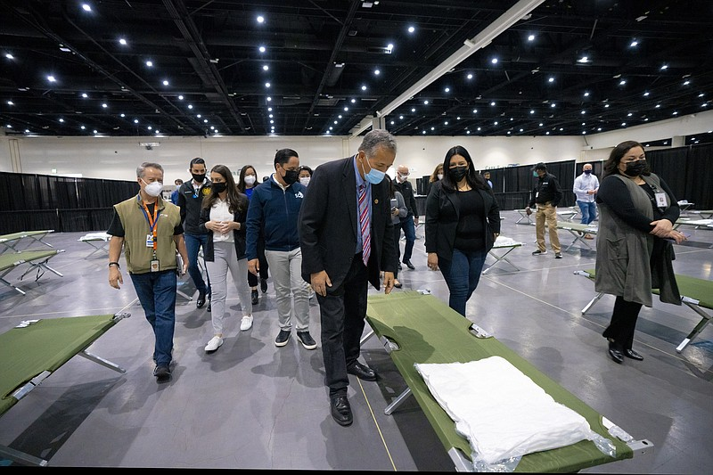 City and county leaders tour the San Diego Convention Center where unaccompan...