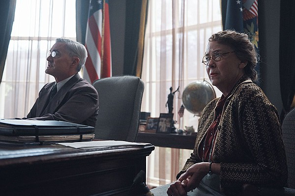 Kyle MacLachlan as President Franklin D. Roosevelt and Ha...