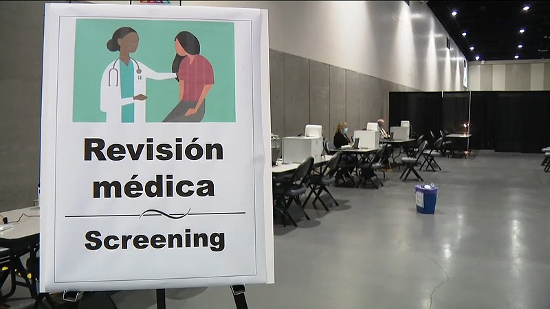 A medical screening station set up inside the San Diego Convention Center for...