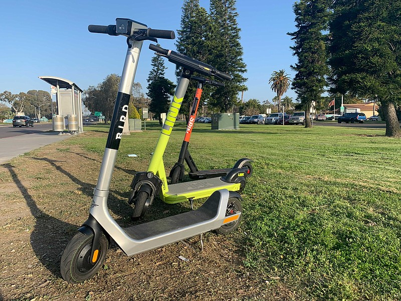 Bird, Link and Spin scooters are seen by an MTS bus stop in Mission Bay Park,...