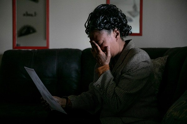Kello Gordon breaks down while looking at a photo of her ...