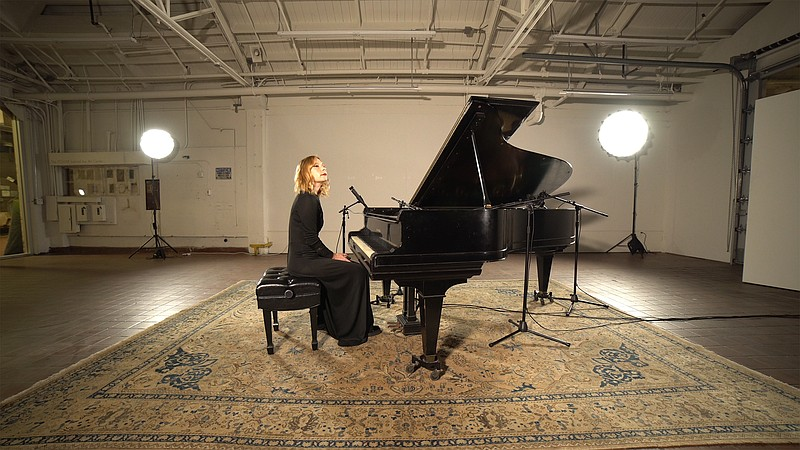 Pianist and vocalist Carrie Feller is pictured recording in the Athenaeum Art...