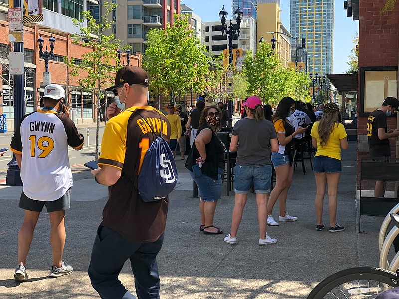 Padres fans celebrate the beginning of the season with food and drinks at res...