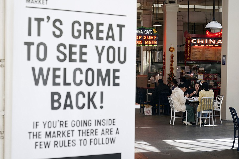 A sign welcomes patrons in an indoor eating space at Grand Central Market Wed...