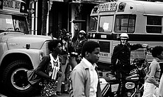 Police and the press observe as Black students ...