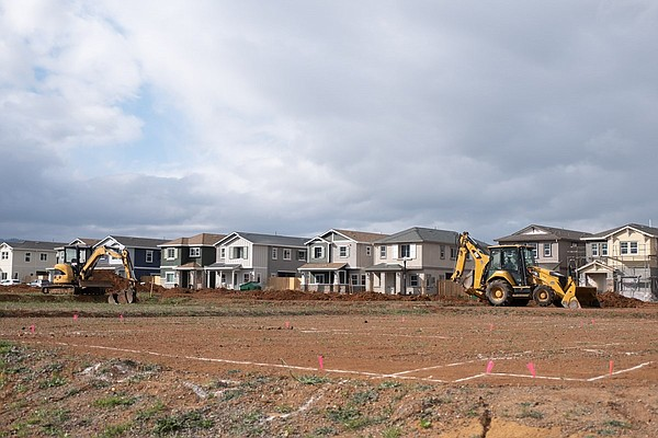Machines ready land for development in Winters, Calif. on...