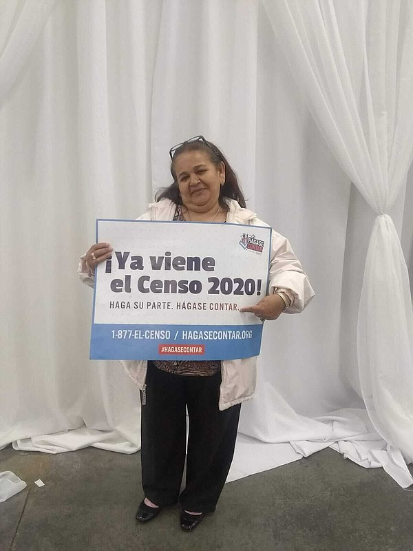 Undated photo of Estela Chamu holding a sign for the 2020...
