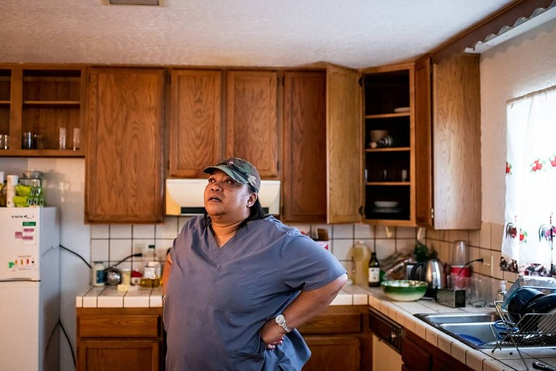 Jocelyn Foreman stands in her kitchen at her home in Pinole on March 19, 2021.