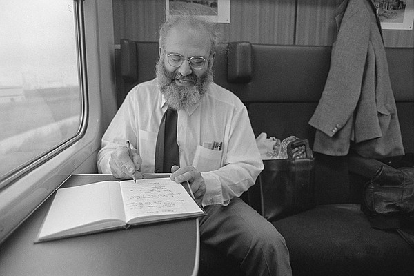 Oliver on train, writing in journal, 1987.