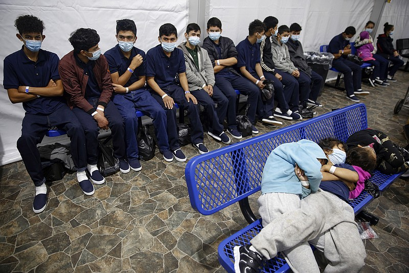In this March 30, 2021, file photo, young unaccompanied migrants wait for the...