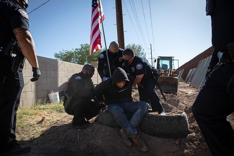 Calexico police officers arrest Hugo Castro who refused to move from the comm...