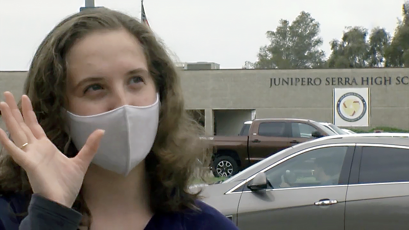 Junior Kate Chasin in front of Canyon Hills High School, formerly Junipero Se...