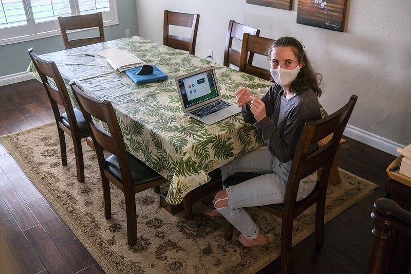 Canyon Hills High School Junior Kate Chasin prepares for a Zoom lecture in he...
