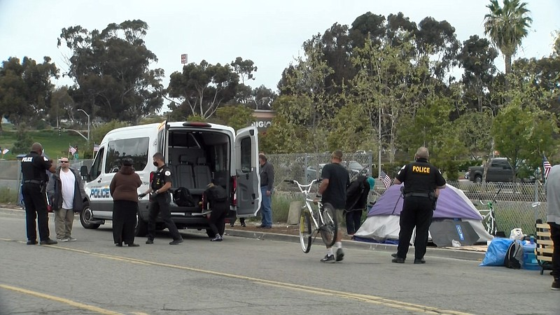 Oceanside Police Department's Homeless Outreach Team helps clear out people l...