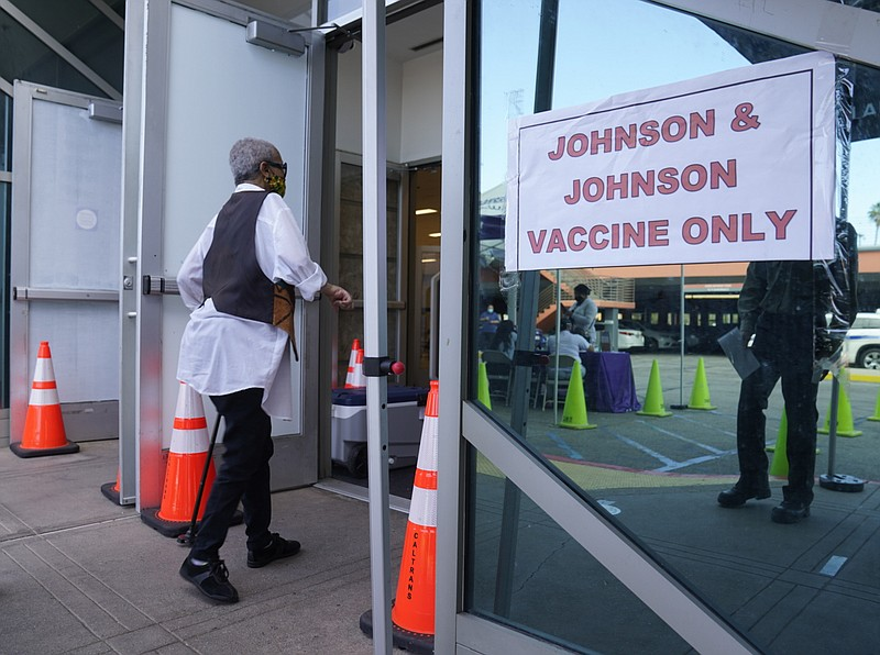 People walk in to get their COVID-19 vaccine at the Baldwin Hills Crenshaw Pl...
